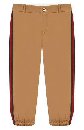 Детские хлопковые брюки GUCCI бежевого цвета, арт. 573996/XWAEW | Фото 1