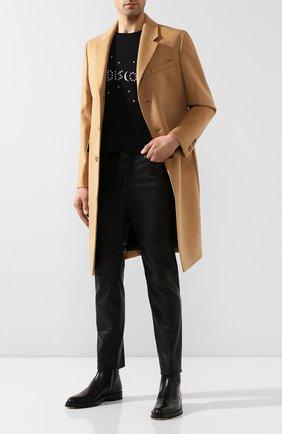 Мужской кожаные брюки SAINT LAURENT черного цвета, арт. 605147/YC2MA | Фото 2