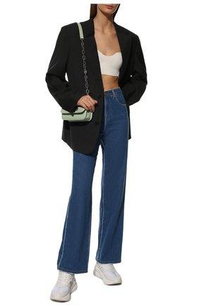 Женские кожаные кроссовки ALEXANDER MCQUEEN белого цвета, арт. 611700/WHXI1 | Фото 2 (Материал внутренний: Натуральная кожа, Текстиль; Подошва: Платформа)