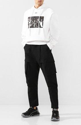 Мужские хлопковые брюки-карго BOTTEGA VENETA черного цвета, арт. 606023/VA8Q0 | Фото 2 (Материал внешний: Хлопок, Синтетический материал; Длина (брюки, джинсы): Стандартные; Силуэт М (брюки): Карго; Случай: Повседневный; Стили: Минимализм)