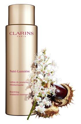 Женского питательный антивозрастной смягчающий флюид nutri-lumiere CLARINS бесцветного цвета, арт. 80058251 | Фото 2