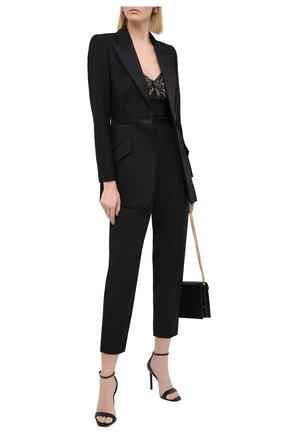 Женские шерстяные брюки ALEXANDER MCQUEEN черного цвета, арт. 629060/QJAAC   Фото 2