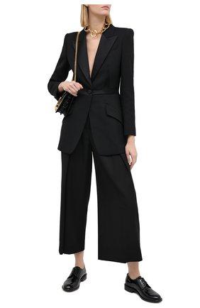 Женские шерстяные брюки ALEXANDER MCQUEEN черного цвета, арт. 627469/QJAAC   Фото 2