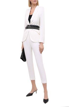 Женские шерстяные брюки ALEXANDER MCQUEEN белого цвета, арт. 585809/QJAAC | Фото 2
