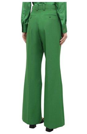 Женские брюки GUCCI зеленого цвета, арт. 643346/ZAFU9   Фото 4 (Материал внешний: Шерсть, Синтетический материал; Длина (брюки, джинсы): Стандартные; Женское Кросс-КТ: Брюки-одежда; Силуэт Ж (брюки и джинсы): Расклешенные; Стили: Романтичный)