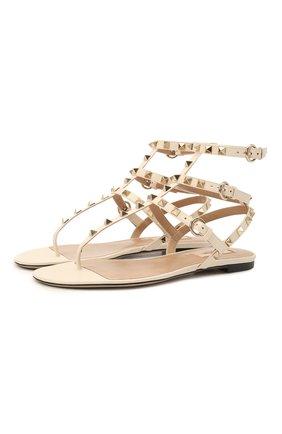 Женские кожаные сандалии rockstud VALENTINO белого цвета, арт. VW2S0812/V0D | Фото 1 (Подошва: Плоская; Материал внутренний: Натуральная кожа; Каблук высота: Низкий)