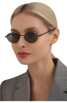 Женские солнцезащитные очки MYKITA черного цвета, арт. NA0K0/BLACK/GREY S0LID 002 | Фото 2 (Оптика Гендер: оптика-унисекс; Тип очков: С/з; Очки форма: Овальные)