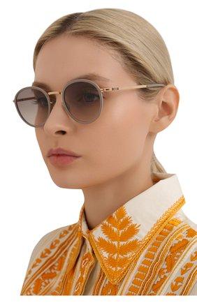Женские солнцезащитные очки MYKITA светло-серого цвета, арт. TUVA/CHAMPAGNEG0LD/BR0WNGR/0RIGINAL GREY GRADIENT | Фото 2 (Тип очков: С/з; Очки форма: Круглые; Оптика Гендер: оптика-женское)
