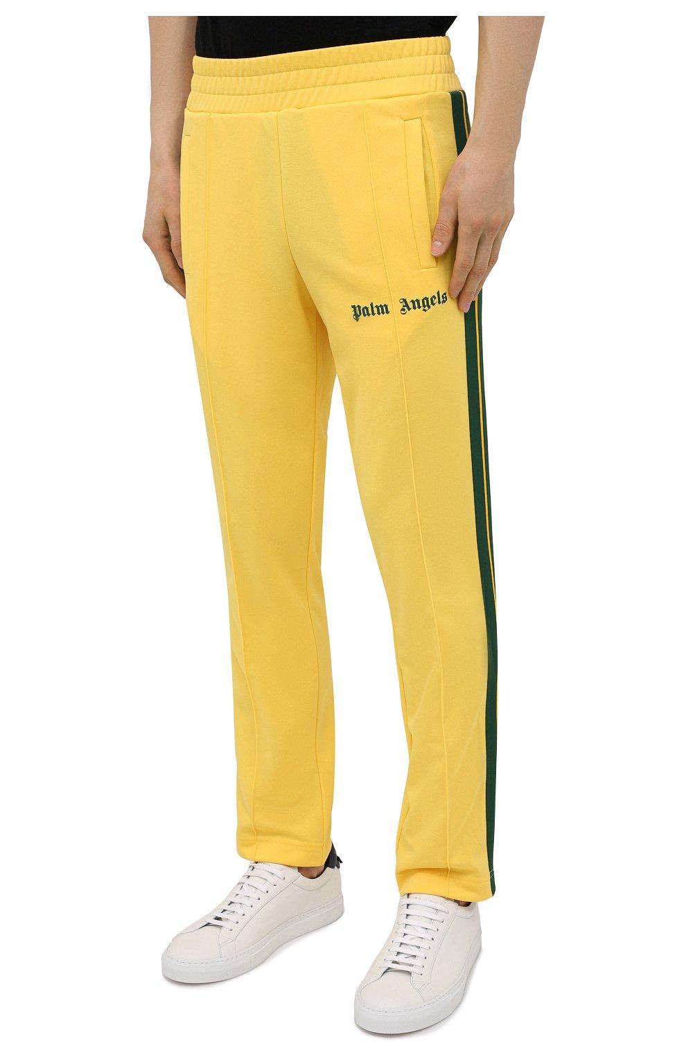 Мужские брюки PALM ANGELS желтого цвета, арт. PMCA007S21FAB0031855   Фото 3 (Мужское Кросс-КТ: Брюки-трикотаж; Длина (брюки, джинсы): Стандартные; Случай: Повседневный; Материал внешний: Синтетический материал; Стили: Спорт-шик)