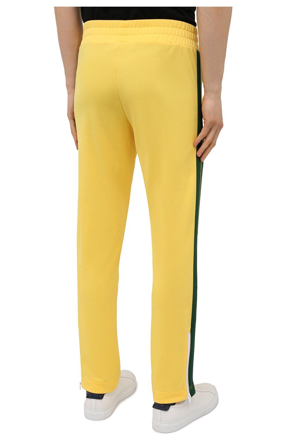 Мужские брюки PALM ANGELS желтого цвета, арт. PMCA007S21FAB0031855   Фото 4 (Мужское Кросс-КТ: Брюки-трикотаж; Длина (брюки, джинсы): Стандартные; Случай: Повседневный; Материал внешний: Синтетический материал; Стили: Спорт-шик)