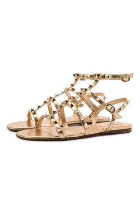 Женские кожаные сандалии rockstud VALENTINO золотого цвета, арт. VW0S0A05/JXH | Фото 1 (Каблук высота: Низкий; Подошва: Плоская; Материал внутренний: Натуральная кожа)