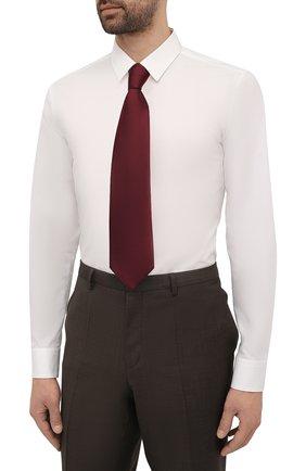 Мужская хлопковая сорочка HUGO белого цвета, арт. 50450147 | Фото 4 (Манжеты: На пуговицах; Воротник: Кент; Рукава: Длинные; Рубашки М: Super Slim Fit; Длина (для топов): Стандартные; Материал внешний: Хлопок; Стили: Классический; Случай: Формальный; Принт: Однотонные)