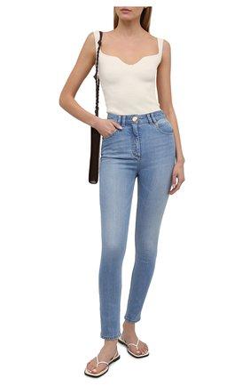 Женские джинсы BALMAIN голубого цвета, арт. VF0MF000/D114   Фото 2 (Материал внешний: Хлопок; Стили: Кэжуэл; Кросс-КТ: Деним; Длина (брюки, джинсы): Стандартные; Силуэт Ж (брюки и джинсы): Узкие)