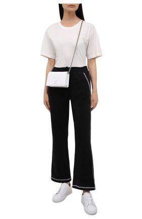 Женские хлопковые брюки REDVALENTINO черного цвета, арт. WR3MD01V/61W | Фото 2 (Материал внешний: Хлопок; Длина (брюки, джинсы): Стандартные; Силуэт Ж (брюки и джинсы): Расклешенные; Стили: Спорт-шик; Кросс-КТ: Трикотаж; Женское Кросс-КТ: Брюки-одежда)