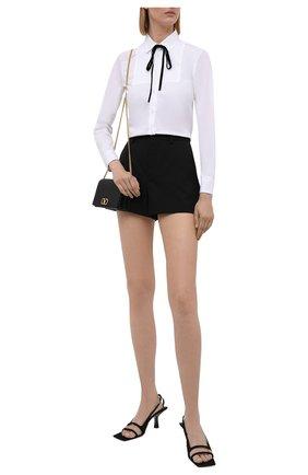 Женская хлопковая рубашка REDVALENTINO белого цвета, арт. WR3ABF55/01Y   Фото 2 (Материал внешний: Хлопок; Длина (для топов): Стандартные; Принт: Без принта; Рукава: Длинные; Стили: Романтичный; Женское Кросс-КТ: Рубашка-одежда)