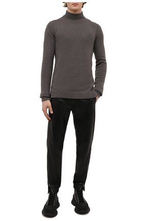 Мужские кожаные джоггеры SAINT LAURENT черного цвета, арт. 664566/YC2MS | Фото 2