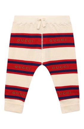 Детские хлопковые брюки GUCCI разноцветного цвета, арт. 653677/XJDJ3   Фото 1