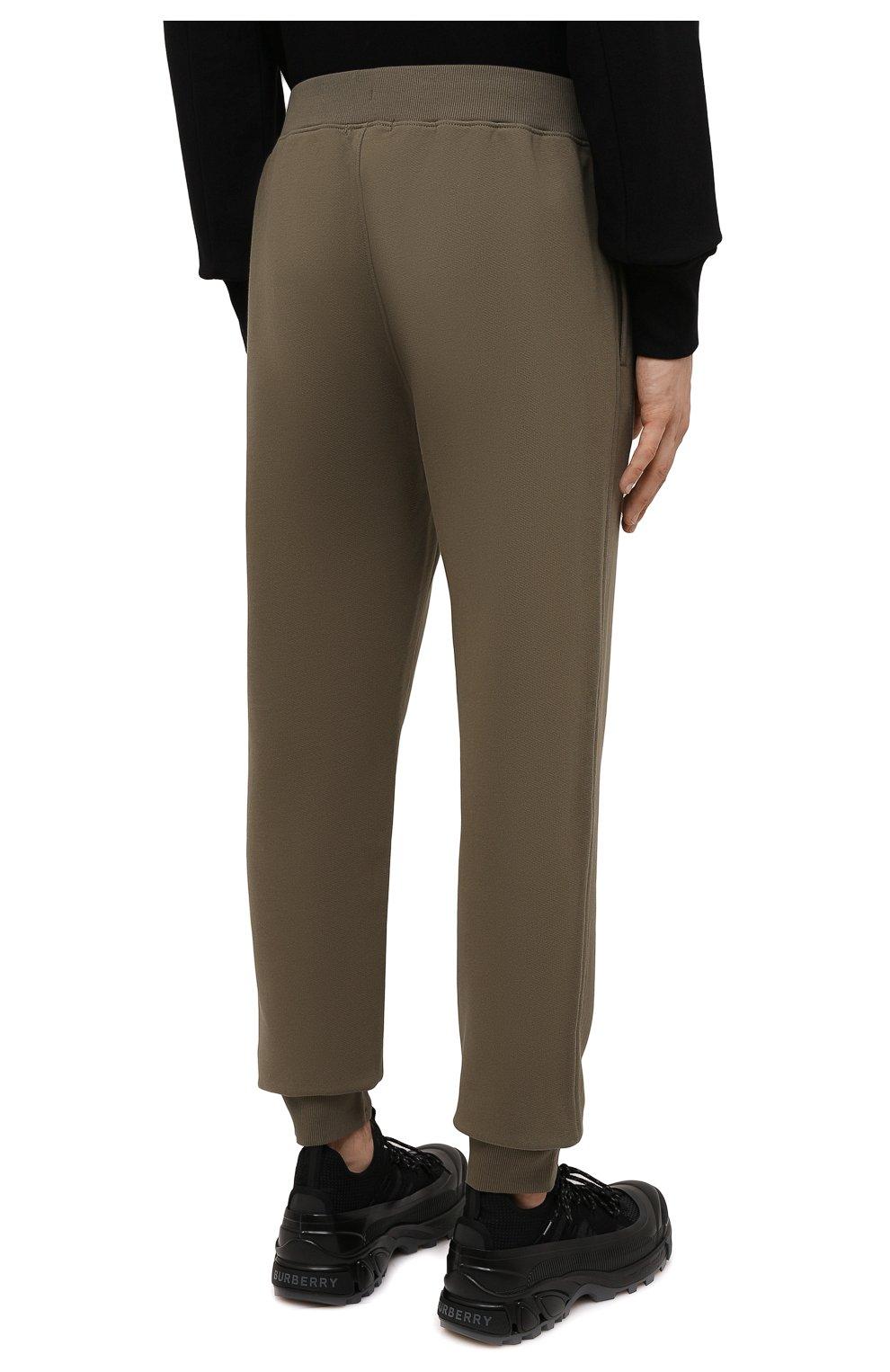 Мужские хлопковые джоггеры C.P. COMPANY хаки цвета, арт. 11CMSP057A-005086W | Фото 4 (Мужское Кросс-КТ: Брюки-трикотаж; Длина (брюки, джинсы): Стандартные; Материал внешний: Хлопок; Стили: Спорт-шик; Силуэт М (брюки): Джоггеры)