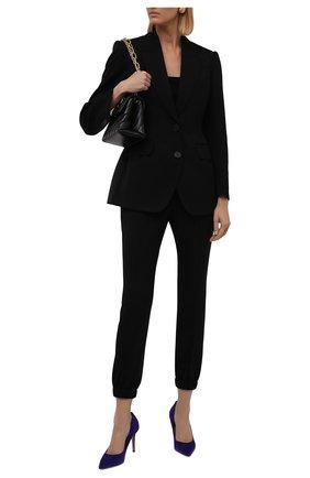 Женские шерстяные брюки ALEXANDER MCQUEEN черного цвета, арт. 663861/QJACH | Фото 2 (Материал внешний: Шерсть; Женское Кросс-КТ: Брюки-одежда; Силуэт Ж (брюки и джинсы): Джоггеры; Стили: Кэжуэл; Длина (брюки, джинсы): Стандартные)