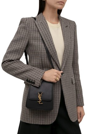 Женская сумка kaia north/south SAINT LAURENT черного цвета, арт. 668809/BWR0W | Фото 2 (Ремень/цепочка: На ремешке; Размер: mini; Материал: Натуральная кожа; Сумки-технические: Сумки через плечо)