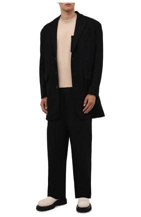 Мужской шерстяное пальто JACQUEMUS черного цвета, арт. 216C0001-1300 | Фото 2 (Длина (верхняя одежда): До середины бедра; Материал подклада: Хлопок; Рукава: Длинные; Материал внешний: Шерсть; Мужское Кросс-КТ: пальто-верхняя одежда; Стили: Минимализм)