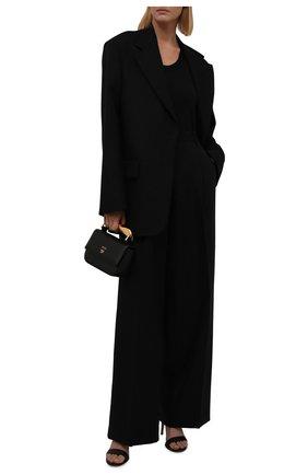 Женские шерстяные брюки DRIES VAN NOTEN черного цвета, арт. 212-010972-3041 | Фото 2 (Материал внешний: Шерсть; Стили: Минимализм; Женское Кросс-КТ: Брюки-одежда; Силуэт Ж (брюки и джинсы): Широкие; Длина (брюки, джинсы): Удлиненные)