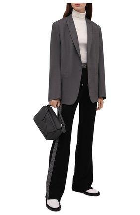 Женские брюки balmain x rossignol BALMAIN черного цвета, арт. WF2P0070/K345   Фото 2 (Материал внешний: Шерсть; Длина (брюки, джинсы): Удлиненные; Женское Кросс-КТ: Брюки-одежда; Стили: Спорт-шик; Силуэт Ж (брюки и джинсы): Расклешенные)