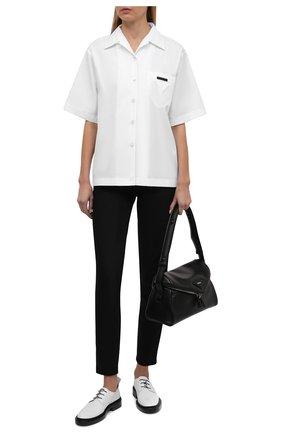 Женские джинсы PRADA черного цвета, арт. GFP456-1W42-F0557-202 | Фото 2 (Материал внешний: Хлопок; Стили: Кэжуэл; Кросс-КТ: Деним; Силуэт Ж (брюки и джинсы): Слим; Длина (брюки, джинсы): Стандартные)