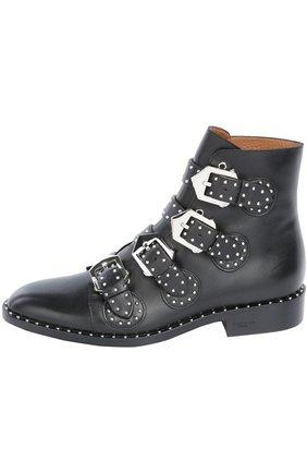 Кожаные ботинки с ремнями и заклепками