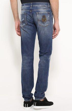 Зауженные джинсы с потертостями и вышивкой | Фото №4