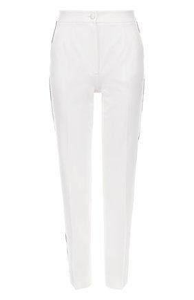 Укороченные зауженные брюки с контрастными лампасами   Фото №1