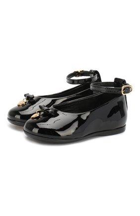 Детские лаковые туфли с бантом и подвеской Dolce & Gabbana черного цвета | Фото №1