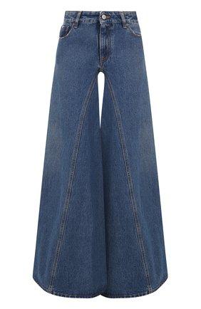 Расклешенные джинсы с потертостями | Фото №1