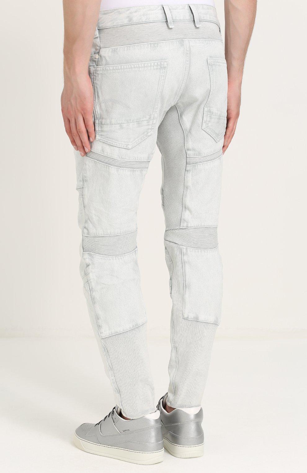 Зауженные джинсы с декоративной отделкой | Фото №4