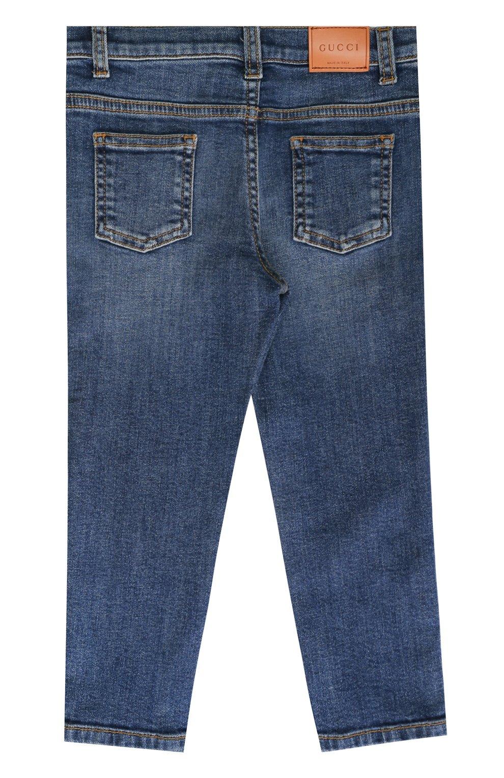 Детские джинсы прямого кроя с декоративными потертостями GUCCI синего цвета, арт. 477472/XR643   Фото 2