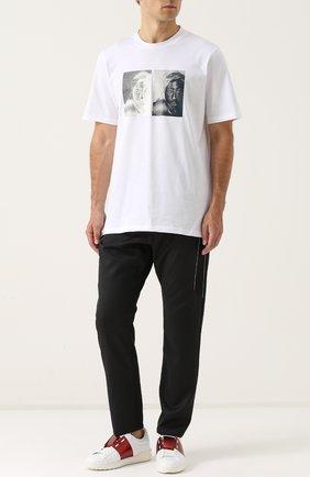 Шерстяные брюки с заниженной линией шага и контрастной прострочкой Oamc черные | Фото №1