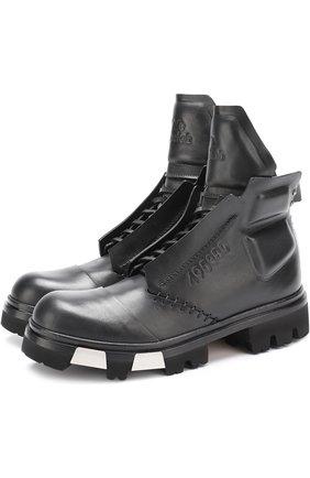 Высокие кожаные ботинки на массивной подошве