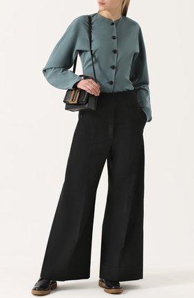 Шерстяные расклешенные брюки со стрелками Christophe Lemaire черные | Фото №1