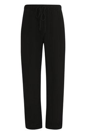 Льняные брюки свободного кроя с заниженной линией шага | Фото №1