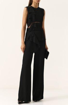 Однотонные расклешенные брюки из шерсти Maison Margiela черные | Фото №1