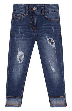 Зауженные джинсы с декоративными потертостями | Фото №1