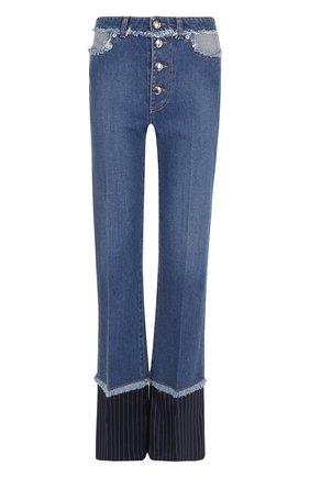 Расклешенные джинсы с потертостями   Фото №1