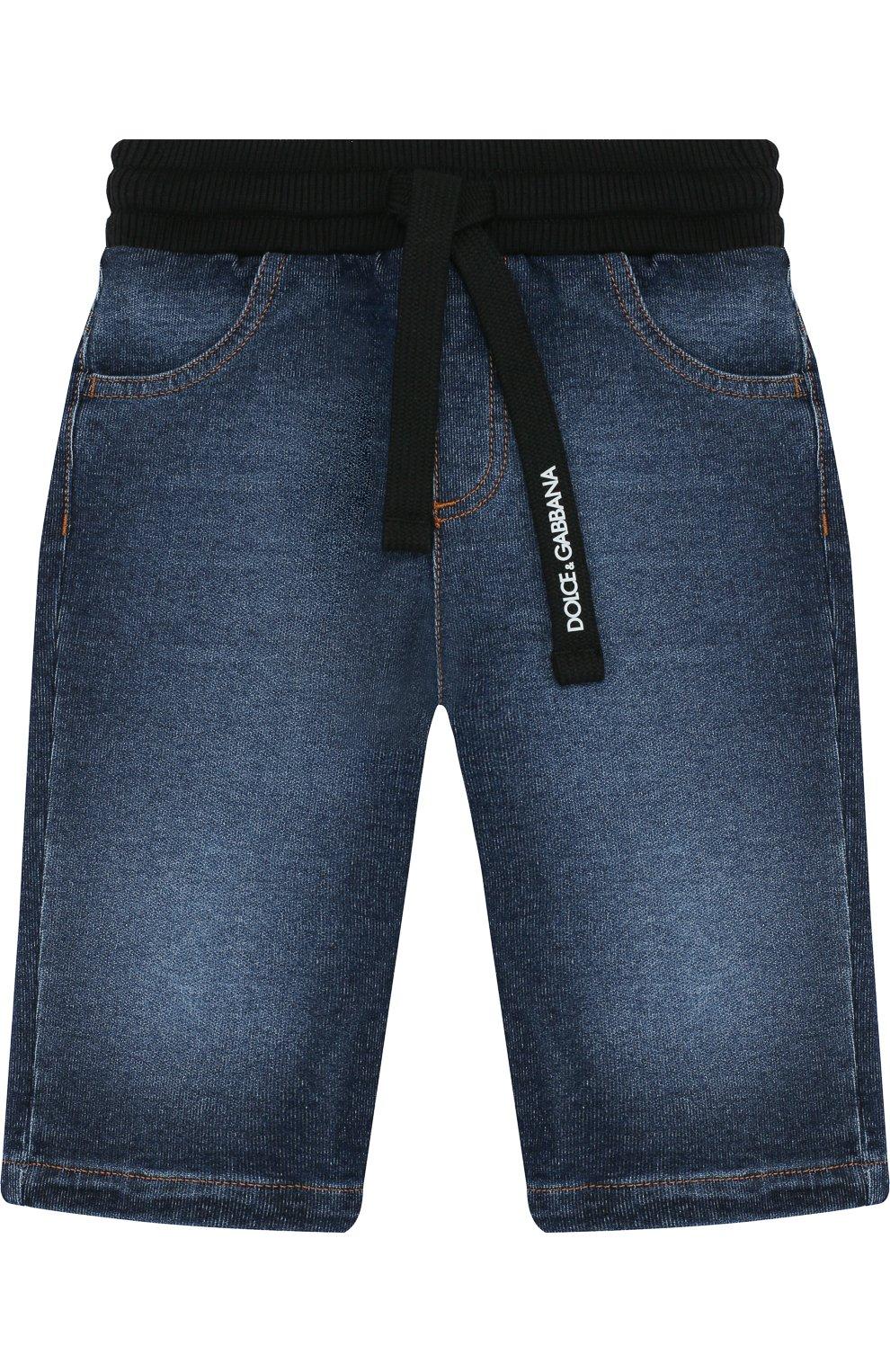 Детские джинсы с декоративными потертостями и эластичным поясом DOLCE & GABBANA синего цвета, арт. L1JPS5/G7MZB | Фото 1