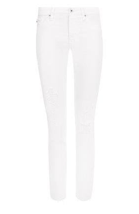 Однотонные джинсы-скинни с потертостями | Фото №1