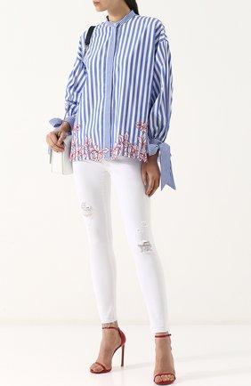 Однотонные джинсы-скинни с потертостями | Фото №2