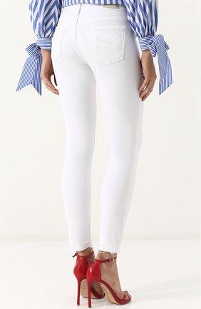 Однотонные джинсы-скинни с потертостями | Фото №4