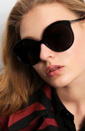 Женские солнцезащитные очки GUCCI черного цвета, арт. GG0257 001 | Фото 2