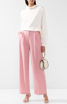 Однотонные шерстяные брюки свободного кроя The Row светло-розовые | Фото №1