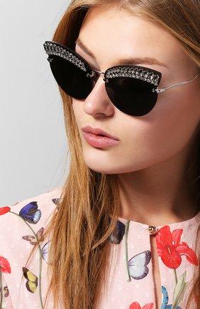 Солнцезащитные очки Miu Miu черные | Фото №1