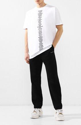 Мужской хлопковые брюки BALENCIAGA черного цвета, арт. 556141/TYK27 | Фото 2